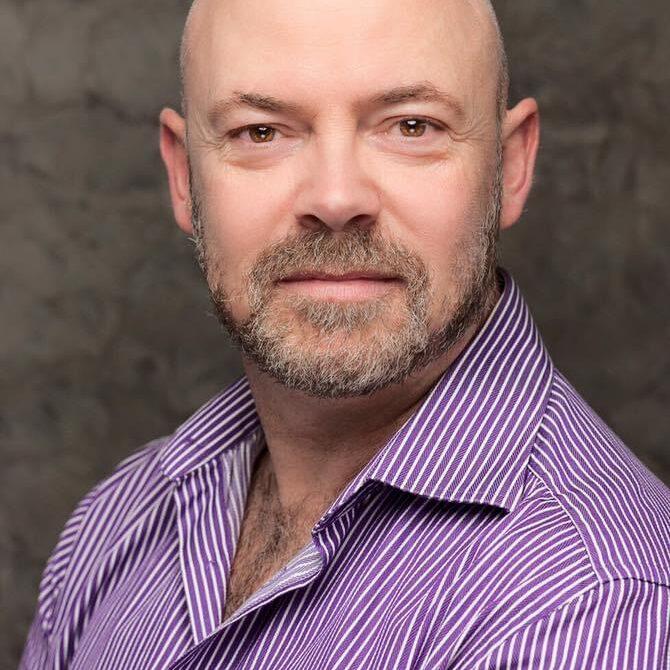Adam Cook headshot